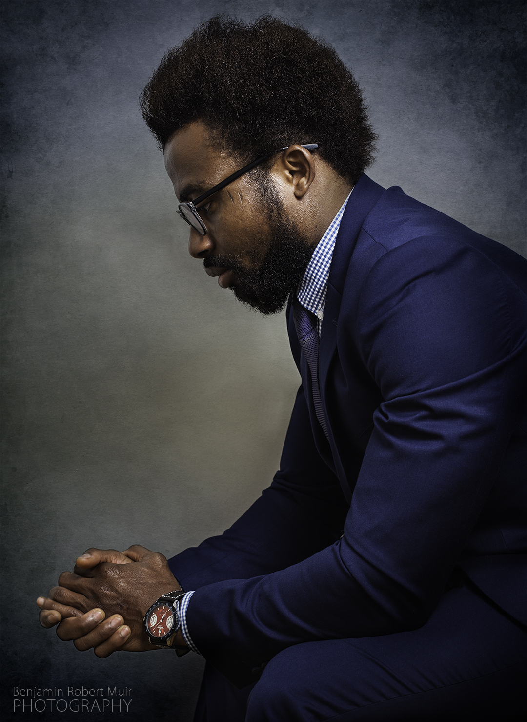 Bristol Fashion Photography -  Black Male Model shoot wearing a Smart Navy Suit shot at Bristol based photography studio